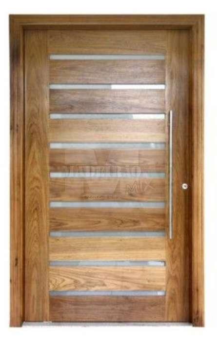 Portas de entrada em madeira maciça - Foto: 17