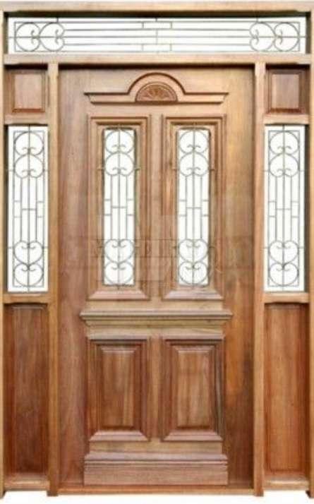 Portas de entrada em madeira maciça - Foto: 18